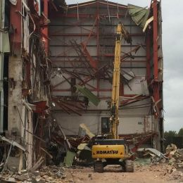 A large building being mechanically demolished